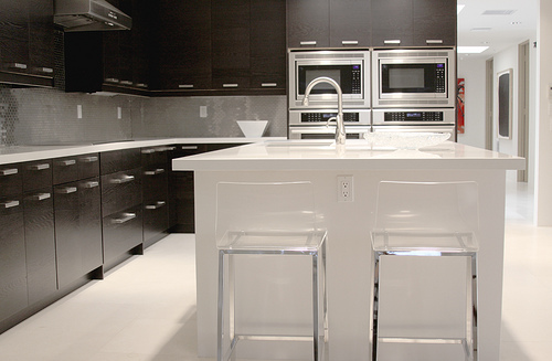 Broad view of a kitchen in white